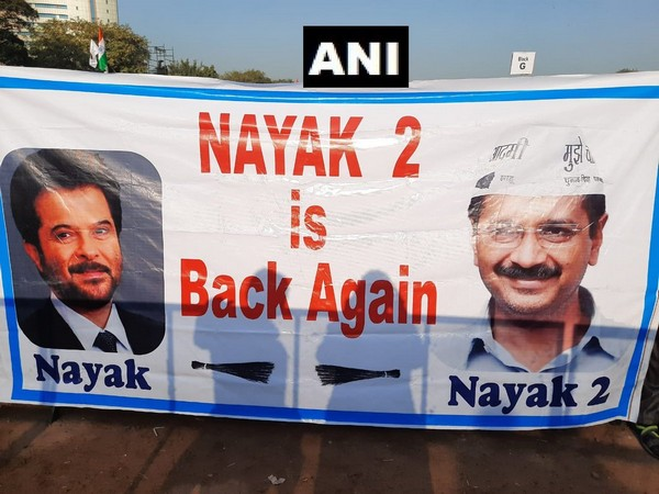 A banner seen at Ramlila Ground where preparations are underway for the swearing-in ceremony of Chief Minister-designate Arvind Kejriwal in Delhi [Photo/ANI]