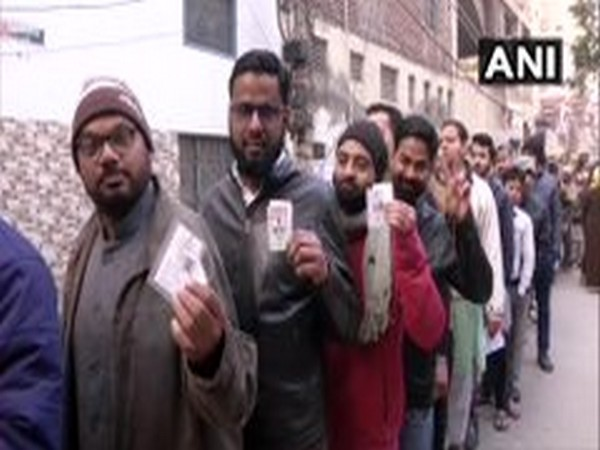 A queue of voters at a polling booth in Shaheen Public School in Shaheen Bagh, Okhla. [File Photo/ANI]