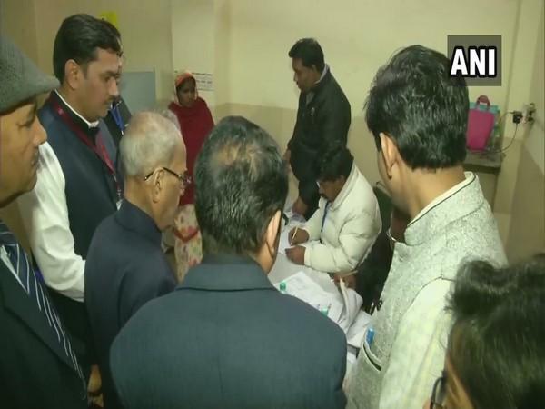Former President Pranab Mukherjee cast his vote at a polling station at Kamraj lane in New Delhi Constituency.