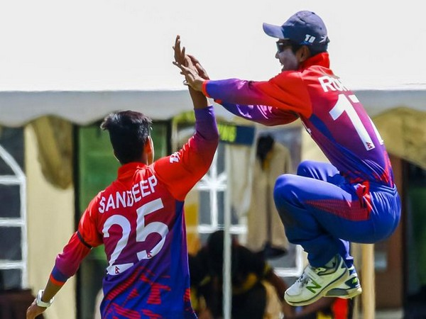 Sandeep Lamichhane celebrates after taking a wicket (Photo/ ICC Twitter)