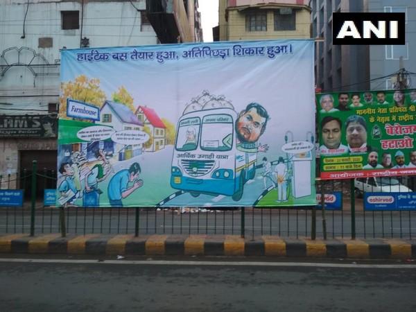 Bihar: Posters against RJD leader Tejashwi Yadav led 'Berozgari Hatao Yatra', seen in Patna. [Photo/ANI]