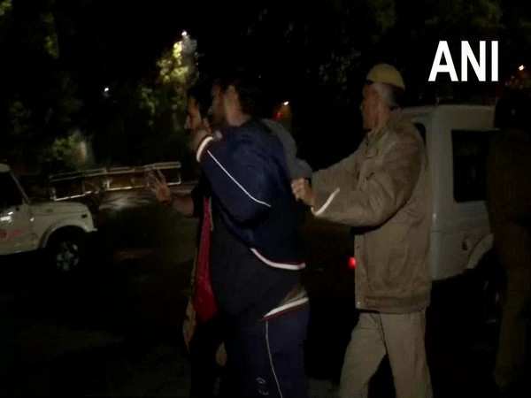 A police personnel dispersing protestors who gathered outside Kejriwal's residence. Photo/ANI