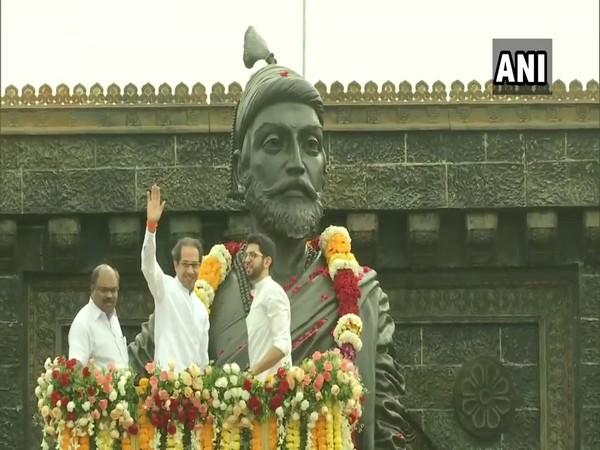 CM Uddhav Thackeray and his son Aaditya Thackeray pay tribute to Chhatrapati Shivaji Maharaj, on Shivaji Jayanti today in Vile Parle, Mumbai. [Photo/ANI]