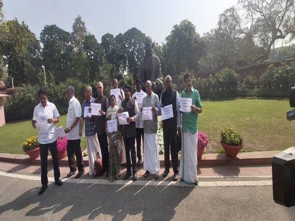 MPs from Left parties protest in front of Gandhi statue [Photo/ANI]