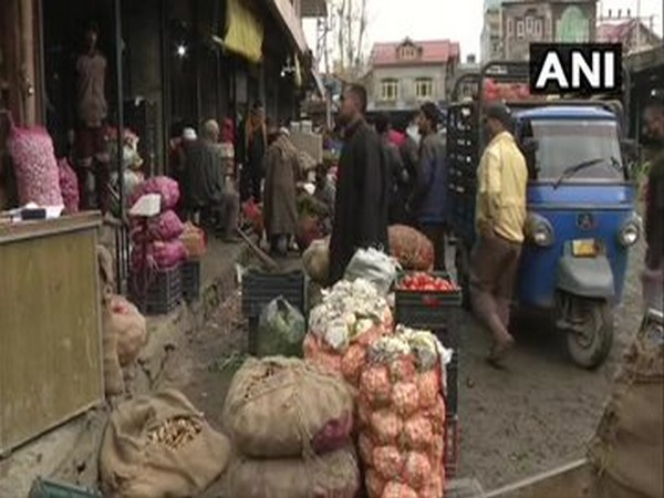 People patiently standing in queues in Srinagar to buy vegetable [Photo/ANI]