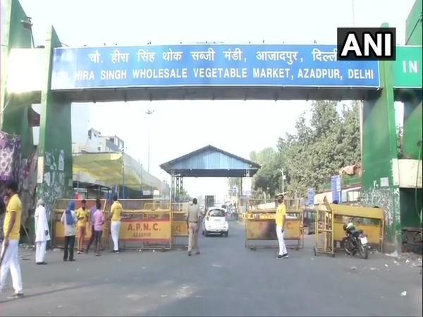 Police checking for passes at the Azadpur Sabzi Mandi entry gate