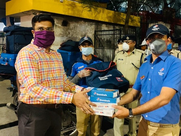 Raipur DIG Arif Shaikh along with Domino's delivery valets (Photo/ANI)