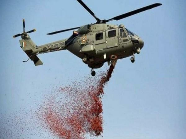 An Indian Air Force chopper showed flower petals on PGIMER in Chandigarh.