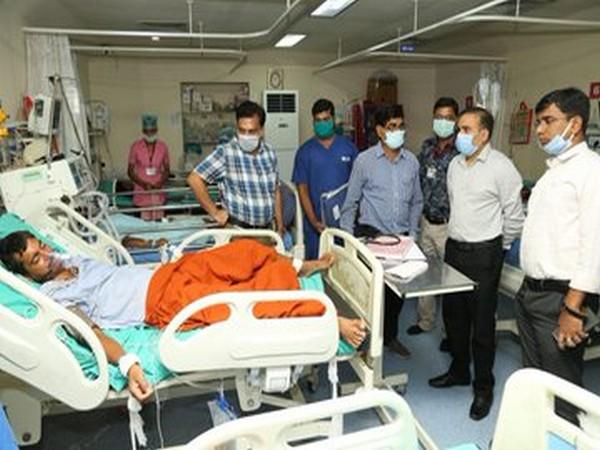 Raigarh Superintendent of Police Santosh Singh and Collector Yashwant Kumar meet gas leak victims on Thursday [Photo/ANI]