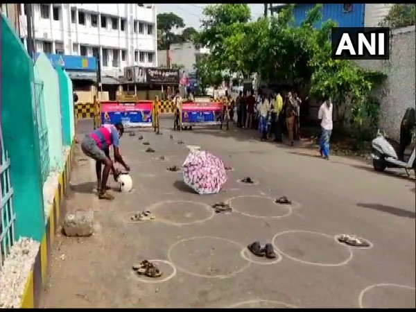 People put their belongings in long queue to save their spot outside liquor shops in Tamil Nadu.