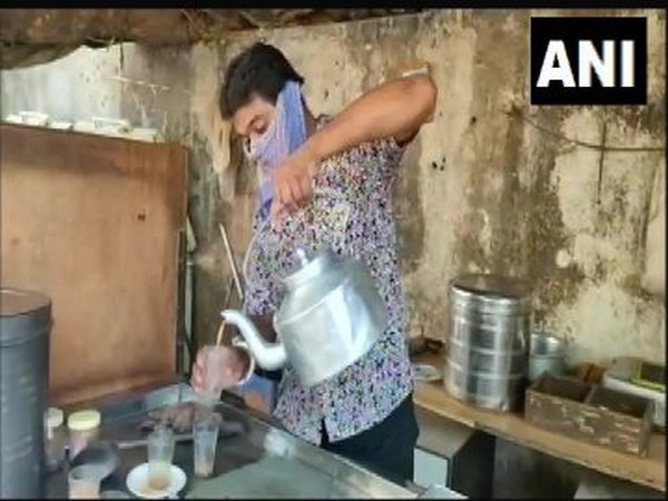 A man selling tea at his shop in Rajkot on Tuesday. [Photo/ANI]