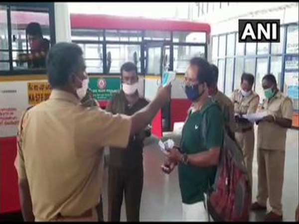 People undergoing thermal scanning before boarding buses in Karnataka. [Photo/ANI]