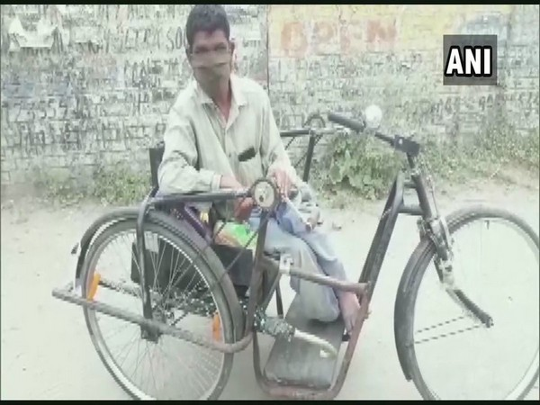 Raju sitting in his tricycle in Pathankot.