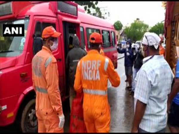 NDRF team evacuating residents living near the seashore from Versova area on Wednesday. [Photo/ANI]