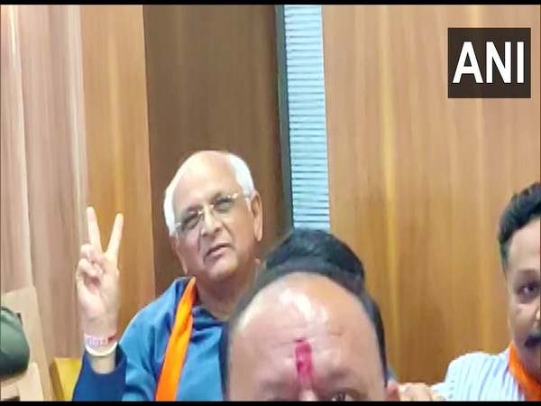 BJP MLA Bhupendra Patel was seen showing a victory sign during the announcement of the new CM of Gujarat at the party office in Gandhinagar (Photo/ANI)