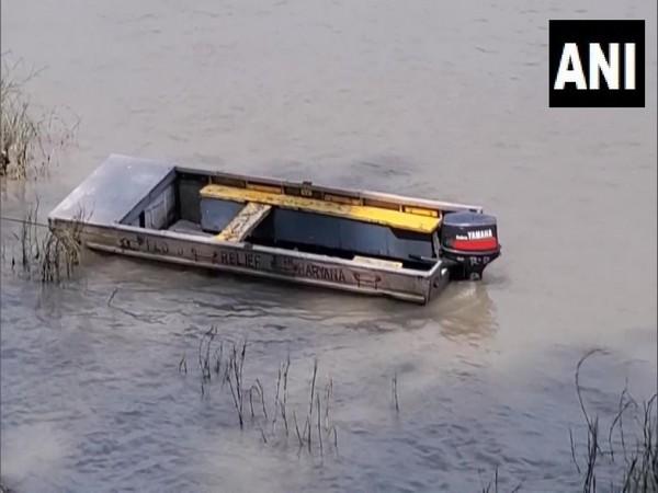 The capsized boat in Yamuna river (Photo/ANI)