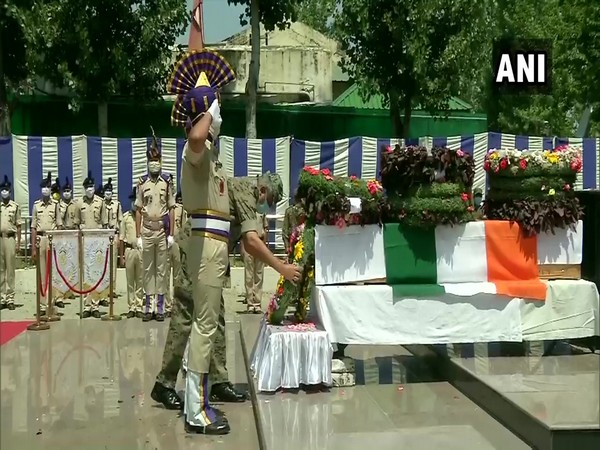 Tributes being offered to the CRPF jawan who lost his life in an encounter in Malbagh, Srinagar. [Photo/ANI]