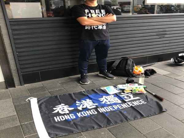 A man was arrested for holding an HK Independence flag.