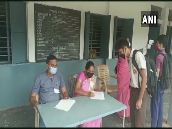 Students got their temperatures checked before they entered the exam hall in Hubli, Karnataka.
