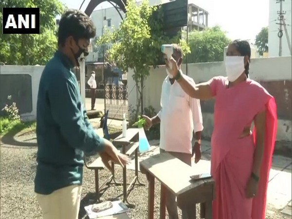 Students got their temperatures checked before they entered the exam hall in Kalburgi, Karnataka.