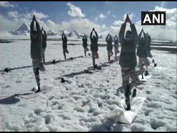 The soldiers of the ITBP performed yoga asanas at an altitude of 18,000 feet on the occasion of the International Yoga Day. [Photo/ANI]