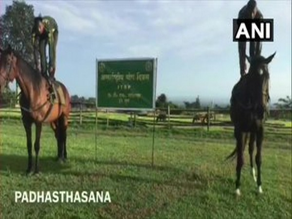 ITBP personnel of Animal Training School, Lohitpur perform yoga with horses on International Yoga Day. [Photo/ANI]