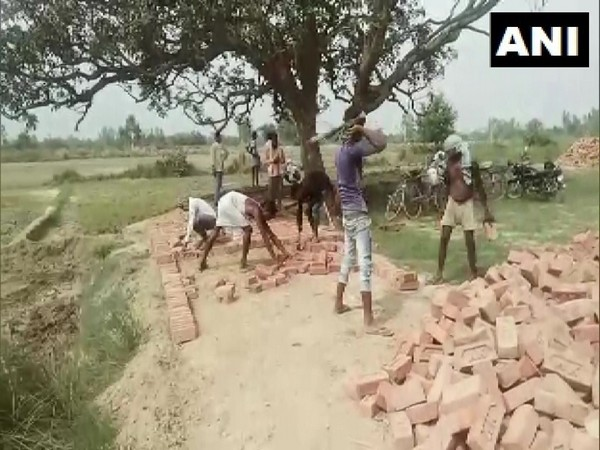 Migrant workers return to Barabanki, Uttar Pradesh to resume work under MGNREGA.