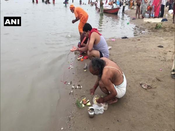 Devotees at Sangam Ghat on the occasion of Guru Purnima.