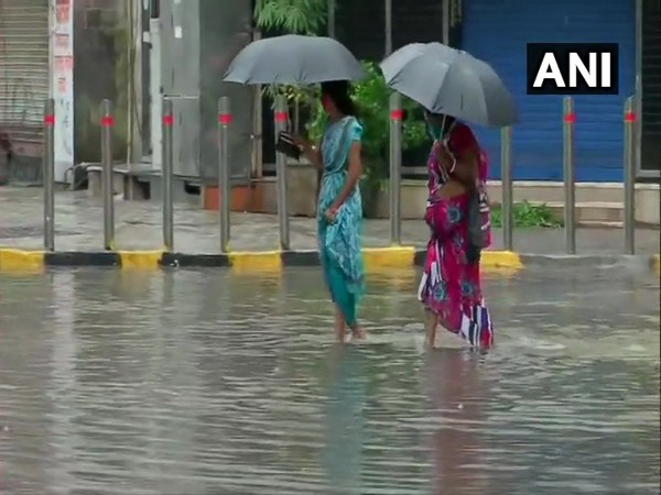 People wading through waterlogged roads in Mumbai's Hindmata area. [Photo/ANI]