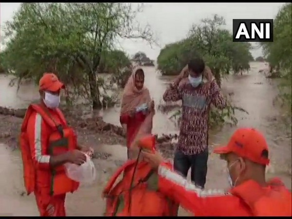 The duo was rescued by the National Disaster Response Force from the Und river in Gujarat after a flood-like situation. [Photo/ANI]