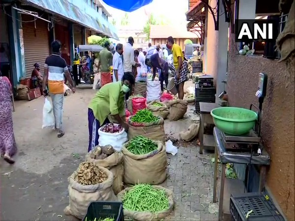 Residents venture out of their homes to buy vegetables in Thiruvananthapuram on Wednesday.