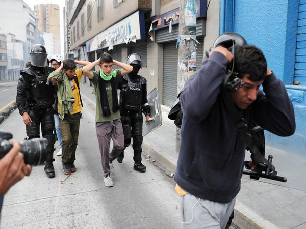 Riot police detain demonstrators during protests in Ecuador (File photo)