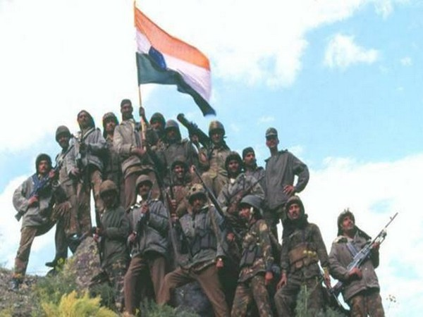 Soldiers holding flag (Image courtesy: Twitter)