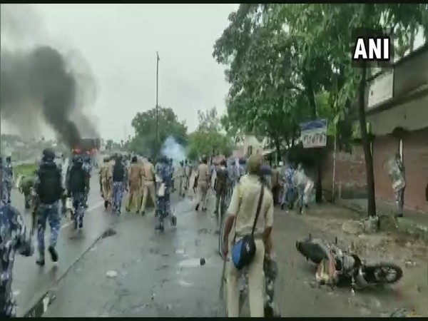 Clash breaks out between security personnel and locals, during the protest against an alleged gangrape and murder of a girl in Kalagachh in Uttar Dinajpur on Sunday (Photo/ANI)