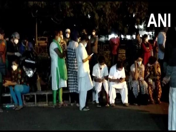 Nurses protesting at the Karnataka Institute of Medical Sciences in Hubli. (Photo/ANI)