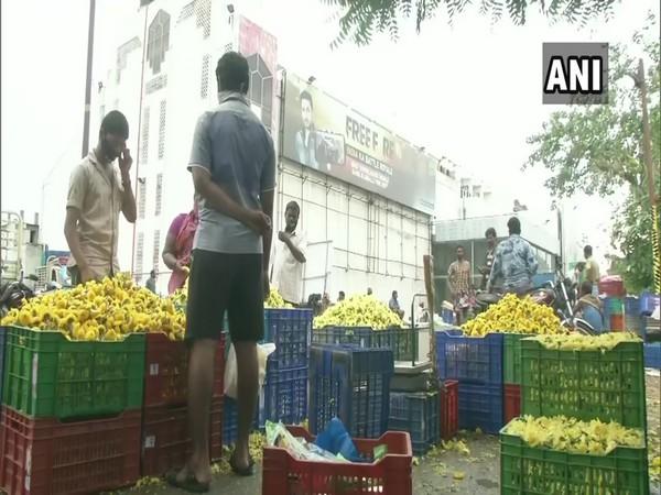 Temporary flower market in front of Rohini theater in Chennai's Koyambedu