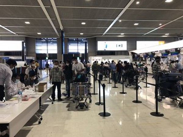 Passengers at Japan's Narita Airport getting ready to board the special Air India flight. (Photo credit: Indian Embassy twitter)