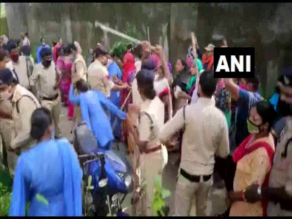 Police baton-charged locals protesting the cremation of a COVID-19 patient's body. (Photo/ANI)