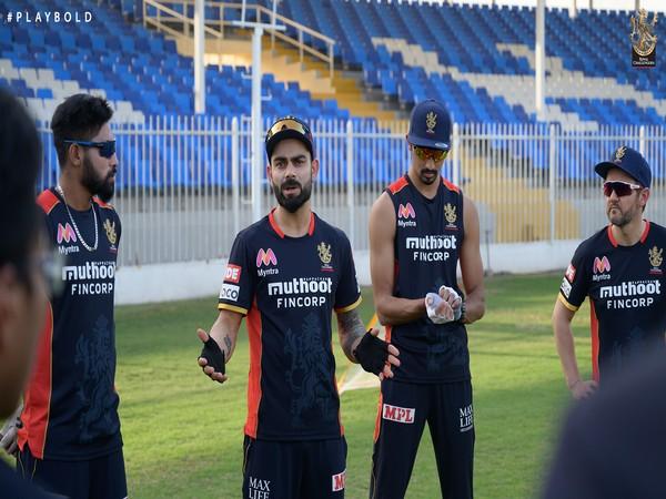 RCB skipper Virat Kohli with his team-mates in Sharjah. (Photo/ RCB Twitter)