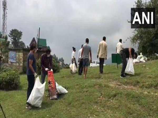 Dhauladhar cleaners collecting garbage in Himachal Pradesh's Dharamshala (Photo/ANI)