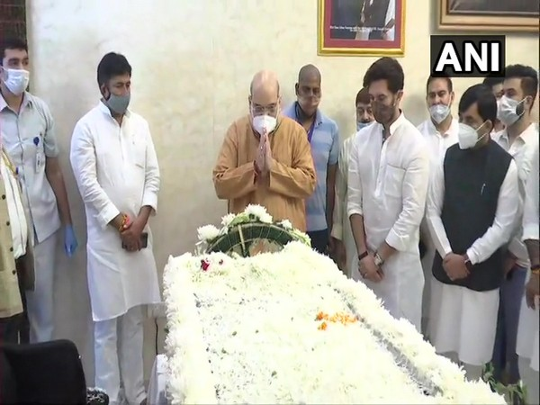 Union Home Minister Amit Shah paying respects to the departed leader. (Photo/ANI)