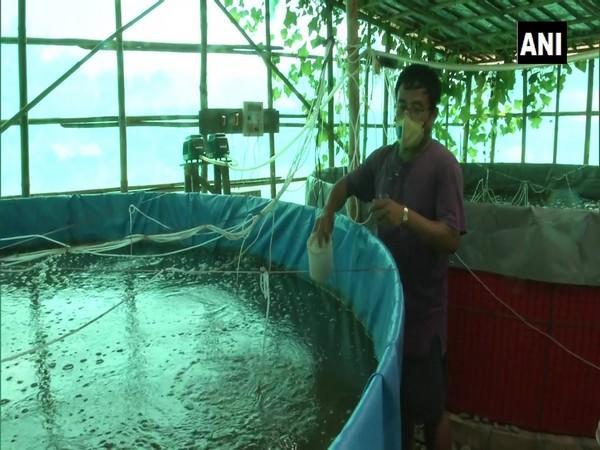 Longjam Boss Meitei, a fish farmer in Manipur's Imphal West shows a Biofloc tank. (Photo/ANI)