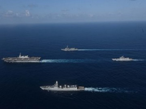 Indian Navy and Japanese Maritime Self-Defense Force (JMSDF) ships conducting operations in close formation at JIMEX-2020.