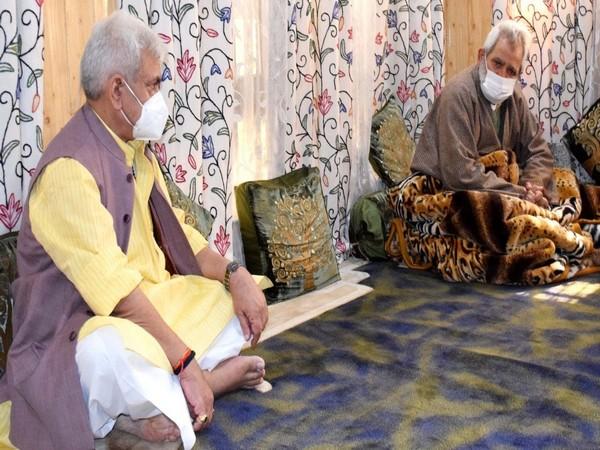 Lieutenant Governor Manoj Sinha with the father of slain advocate Babar Qadri.