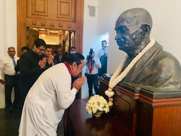 Sri Lankan Prime Minister Mahinda Rajapaksa paying tribute to Mahatma Gandhi on Friday. (Photo credit: India in Sri Lanka Twitter)