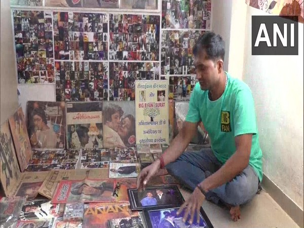 Divyesh Kumar with his collection of pictures. (Photo/ANI)