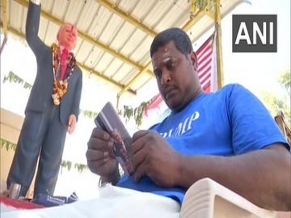 Bussa Krishna Raju near President Donald Trump's statue at his home in Medak. (File Photo/ANI)