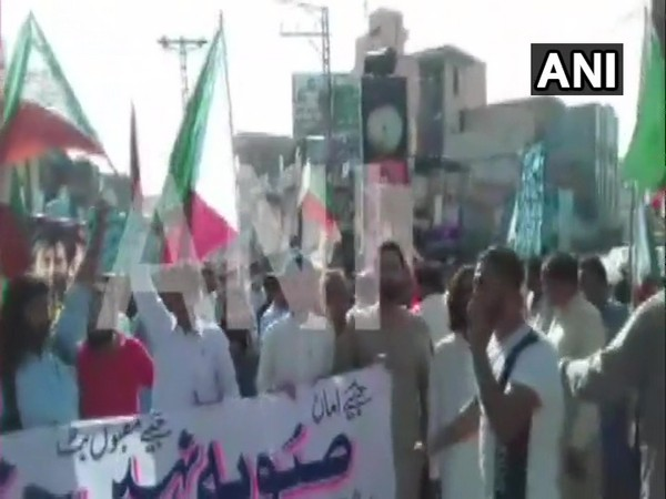 People from Gilgit Baltistan carried out demonstrations in Muzaffarabad (PoK), Karachi and Hunza against Pak govt's attempt to alter the status of Gilgit Baltistan by making it a province. (Photo/ANI)