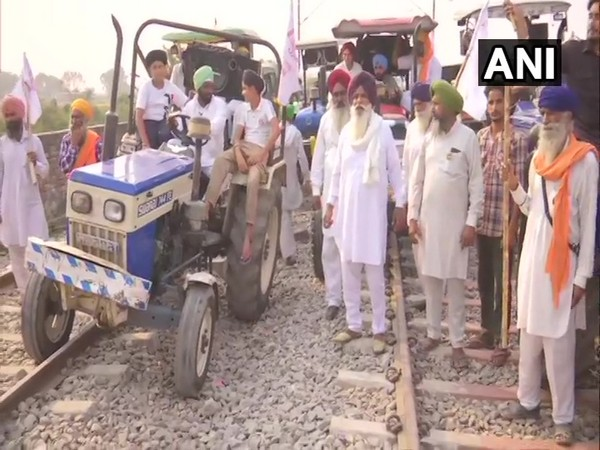 Farmers in Amritsar blocking railway track during 'Rail Roko' agitation on 20th day (Photo/ANI)