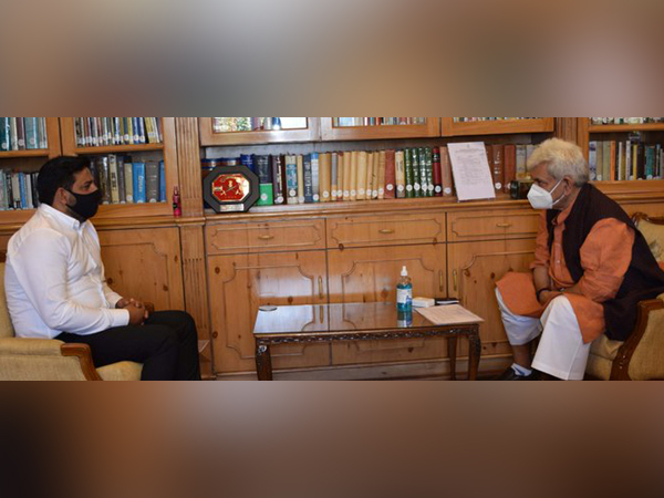 Rajya Sabha MP Mir Mohammed Fayaz with Lieutenant Governor Manoj Sinha on Tuesday. (Photo Credits: DIPR-J&K Twitter)